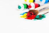 Brush with multicolored paint