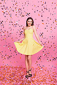 Glamour girlish feminine style stylish trendy graceful elegant carnival concept. Vertical full-length full-size portrait of excited cheerful girl holding dotted dress bottom isolated on background