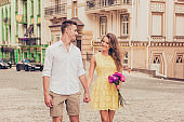 couple in love walking on street and holding hands