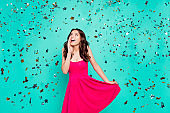 14-february, win, winner, reaction emotion concept. Portrait of beautiful, attractive curly brunette lady short cocktail pink wear look up hold palm near face isolated on vivid turquoise background