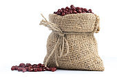 red bean  in canvas sack on white background