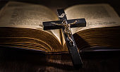 Holy bible with wooden cross in vintage style