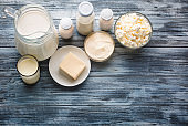 Dairy products grocery assortment on rustic wooden table