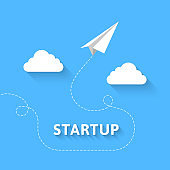 Startup concept with paper plane flying through the sky