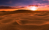 Sunset over the dunes of Maspalomas. Island of Gran Canaria