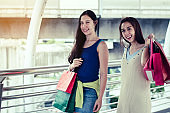 fashion shopping concept : beautiful teenager women smile walking after purchase mall