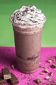 takeaway glass of iced shake frappe mocha coffee drink with white whip cream topping