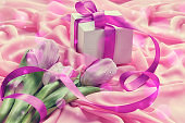 Purple tulips on pink textil background