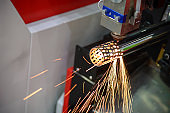 The fiber laser cutting machine cutting the stainless pipe