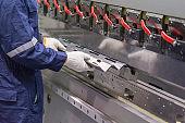 The technician operator use hydraulic bending machine.