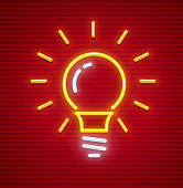 Electric bulb with base shine neon icon