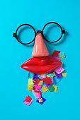 confetti, fake glasses, nose and mouth
