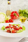 Salad with cherry tomatoes mozzarella, greens.