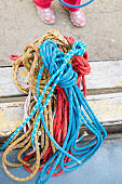 climbing equipment ropes carbines backpacks suspension for sitting climber and special shoes for rock climbing