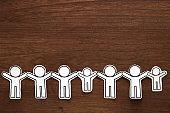 Human paper cut illustration vector on brown wood.  Teamwork concept. Social Network concept.