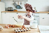 Cooking with kids. Happy funny children preparing the dough, bake cookies in the kitchen