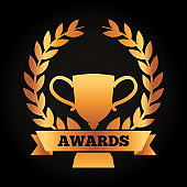 award winning success gold cup laurel wreath and ribbon on a black background