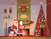 santa claus in living room decorated for christmas new year holiday sit armchair pine tree fireplace read letter wish list home interior concept flat