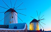 Windmills in Mykonos at sundown
