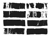 Abstract black smears of paint isolated on white background. Rectangular spots created with paint roller and black acrylic. Rectangular text box. Hand drawn textured design elements.