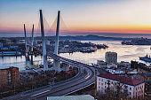 Golden bridge and Golden Horn bay at sunset, Vladivostok, Russia