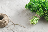 Bunch of parsley on grey concrete background