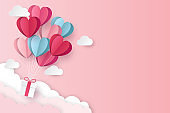 illustration of love and valentine day with balloon heart and clouds. Paper cut style. Vector illustration