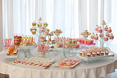 Table with cakes, cookies, cupcakes, tarts