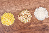 Millet groats, white buckwheat and rice, healthy and gluten free food concept
