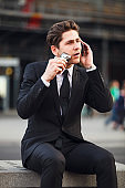 Busy Businessman With Phone And Electric Razor