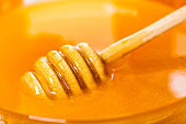 wooden spoon in honey closeup