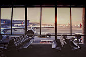 modern airport terminal and airplane waiting in the gate