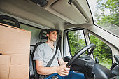 driver man driving delivery truck car vehicle, service of delivering package cargo