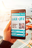 Boarding pass with QR code displayed on mobile phone