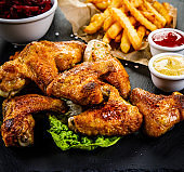 Chicken wings, French fries and vegetables