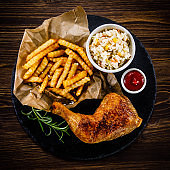Fried chicken leg with French fries