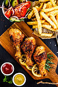 Fried chicken drumstics with French fries