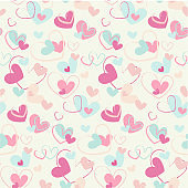 Hand drawn hearts seamless pattern. Cute brush painted chaotic pink red blue heart shapes on white background.