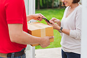 Asian delivery man deliver box parcel package to customer at home, shipping delivery concept