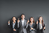 Portrait group of Asian business people in formal suit over black background