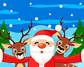 Santa Claus takes a selfie with reindeer in the winter forest. Christmas