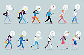 Set of business people walking using their mobile devices