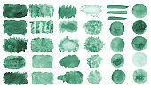 Collection of hand-made green watercolor painted brushes, smears, blobs, stains, circles, stripes, stickers, spot, blots, slick, web buttons, patch backgrounds creative decorative elements Isolated