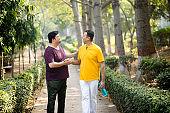 Two men greeting at park