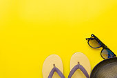 Vibrant Retro youth fashion flat lay on top view yellow background texture concept for minimal summer product mock up, uv protect outfit design, beach set for weekend vacation.