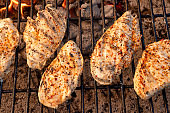 Chicken Breasts Being Grilled on a Fiery Old Fashioned Charcoal Grill, Perfect Ketogenic Diet Food