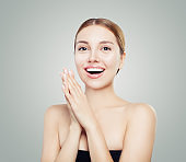 Excited woman laughing. Happy surprised girl portrait
