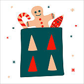 Christmas gift bag containing gingerbread, candy and an icicle New year toy in scandinavian hand drawn style. Vector illustration, square format. Suitable for a greeting card or banner