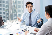 Financial broker explaning business data to his client