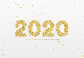 2020 New Year. Text of shiny golden confetti, tinsel sparkles with bright serpentine.